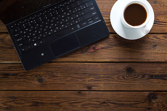 Laptop and a cup of coffee on a desk